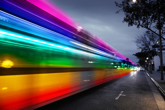 fast moving traffic creates rainbow blur